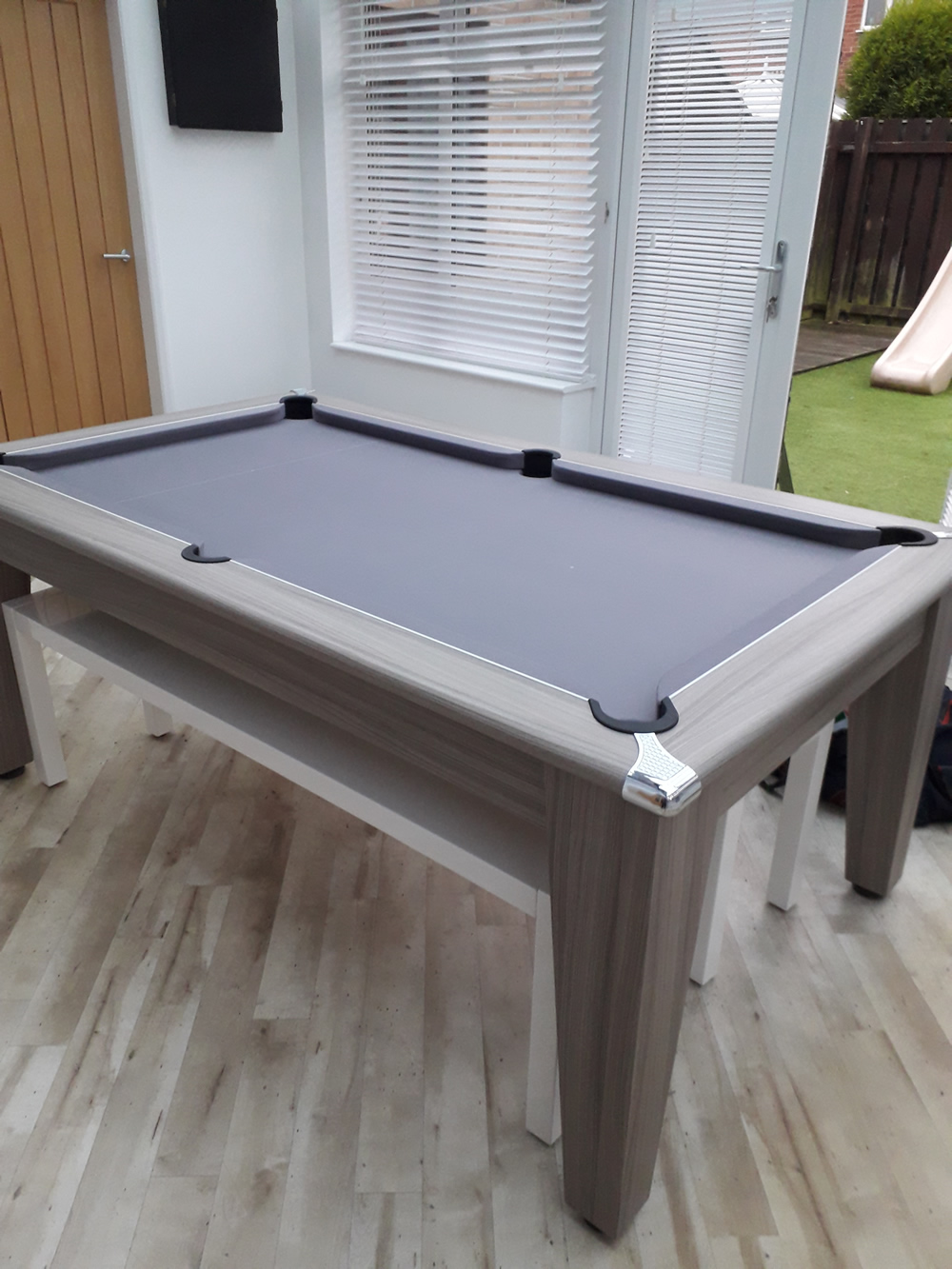 Recover of a Gatley pool dining table in Hainsworth silver napped wool cloth