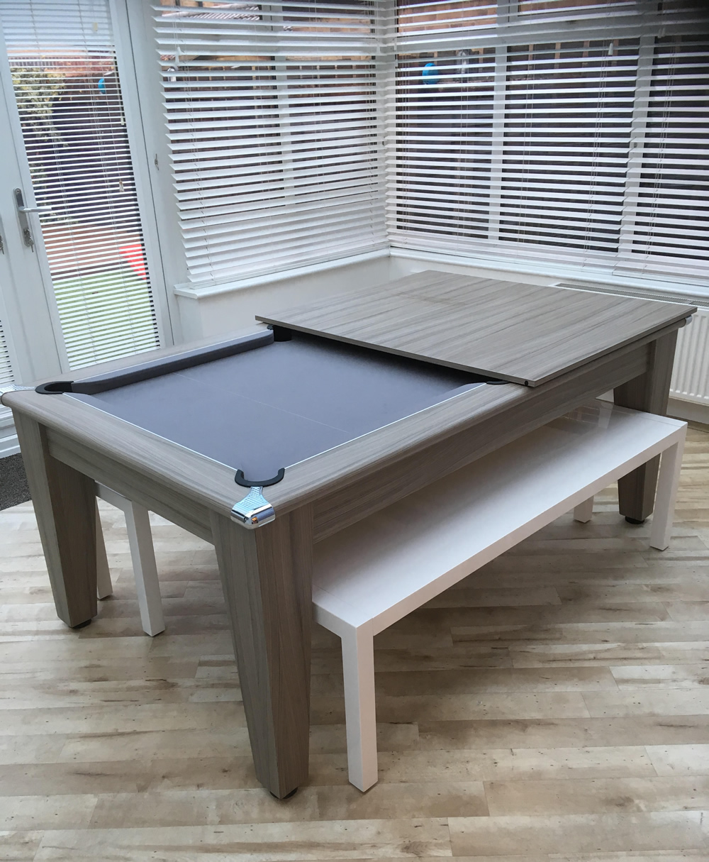 Driftwood dining pool table recovered in silver wool cloth