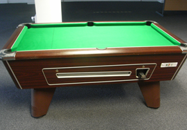 Recovered pool table in green nylon cloth