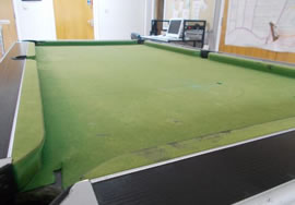 Recovered pool table in blue nylon cloth