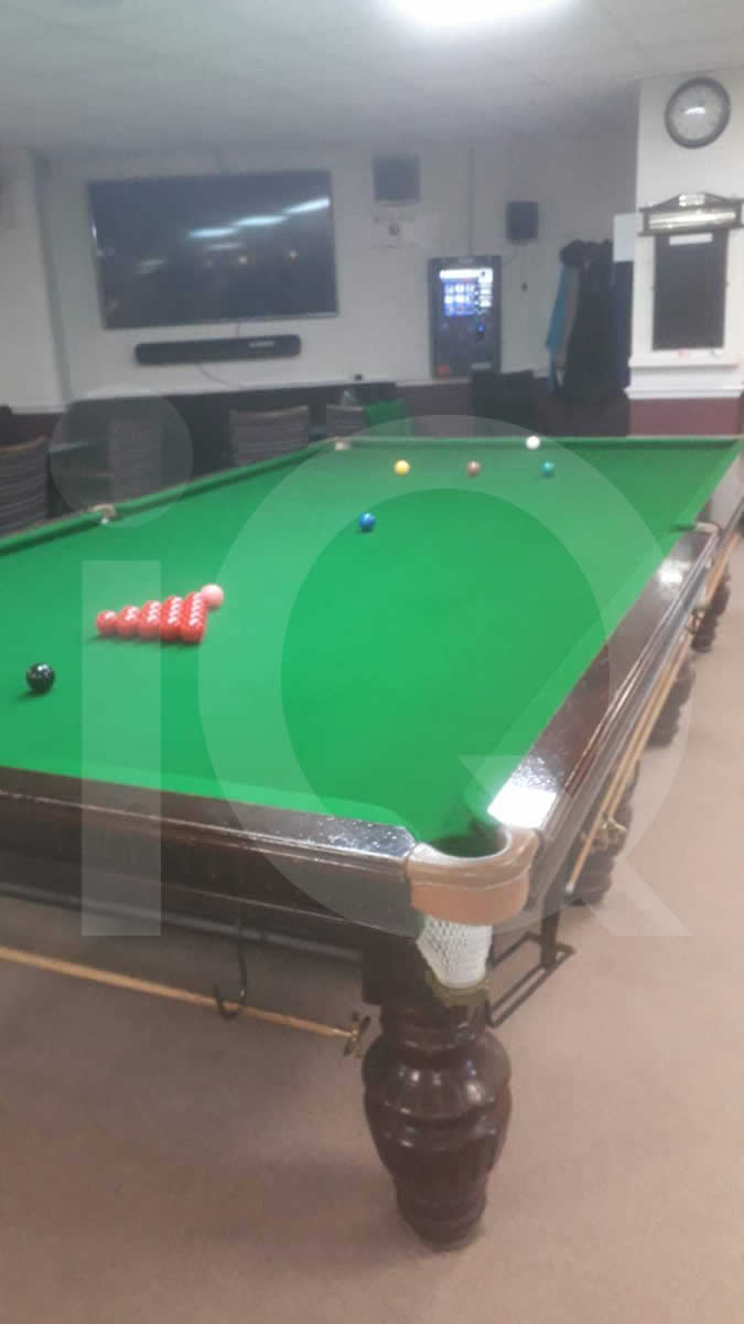 Green cloth replaced on a snooker table
