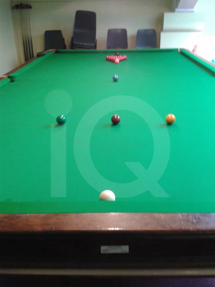 A Grey Snooker Table recovered with Green Cloth