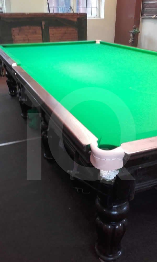 A Snooker Table being recovered in Green Cloth